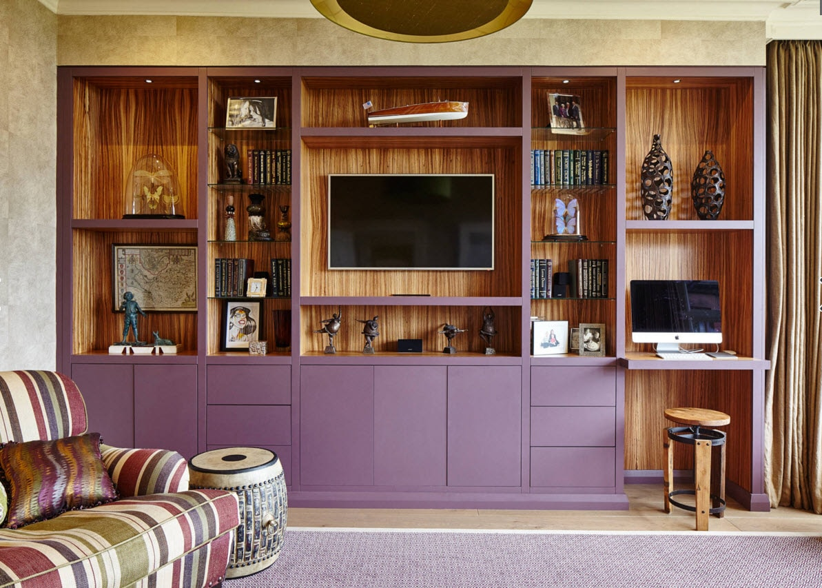Storage Systems Variety for the Living Room. Dark wooden basis for the storage system of the wall length with purple facades looks rich and solid