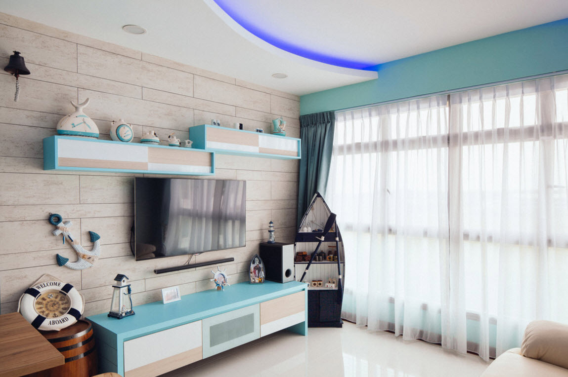 Hi-tech and Marine Style Mix for Small Apartment. Creators even allocate some space for the decorative boat to create more naturalistic seaside atmosphere