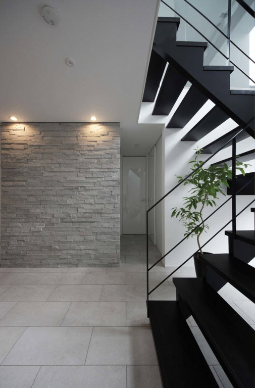 hi-tech style for private house in Japan. Special gray texture for the wall finishing and the steel black stairs