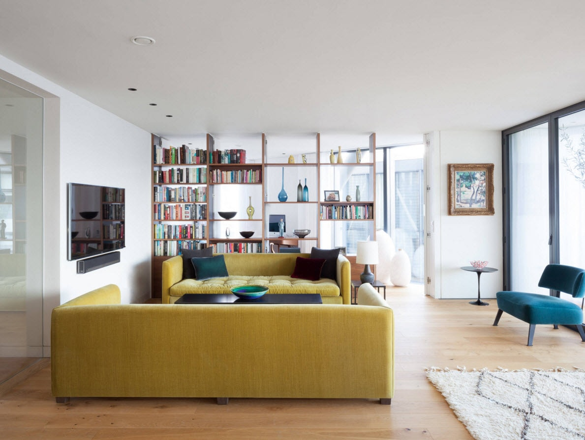 Storage Systems Variety for the Living Room. Yellow furniture set in the spacious zoned area with the wooden racks for books and other personal things