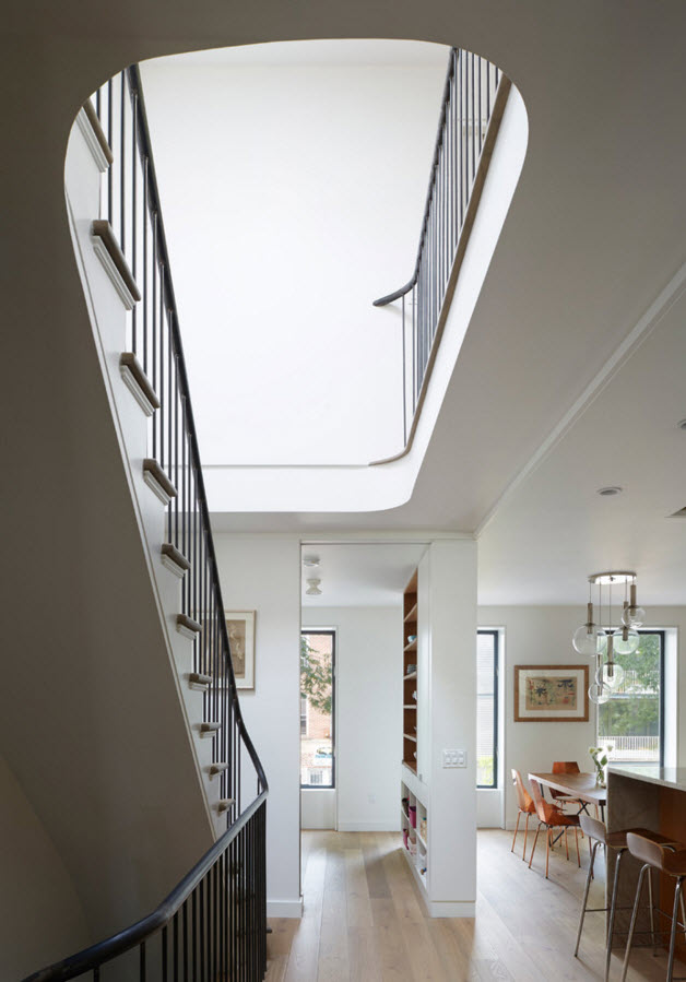 Perspective of the staircase and both floors of the contemporary styled house