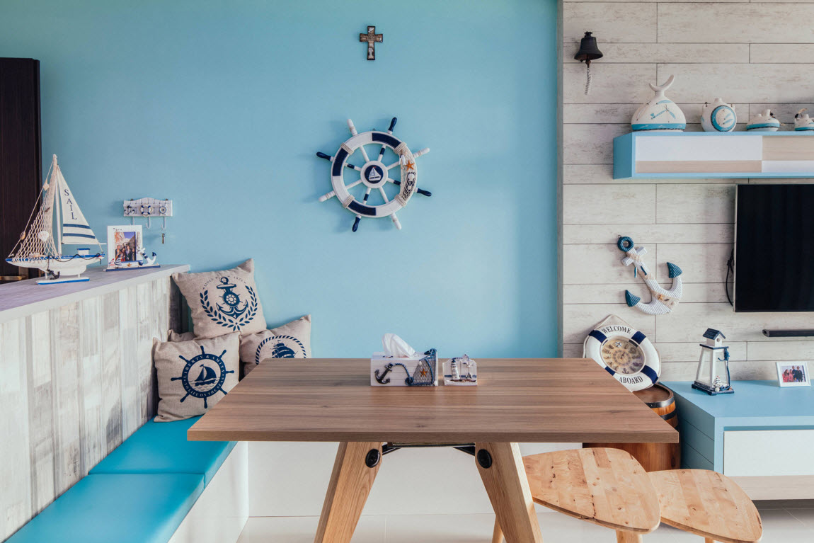 Hi-tech and Marine Style Mix for Small Apartment. The living space is full of allusions to nautical theme: helm, pillows with anchors etc