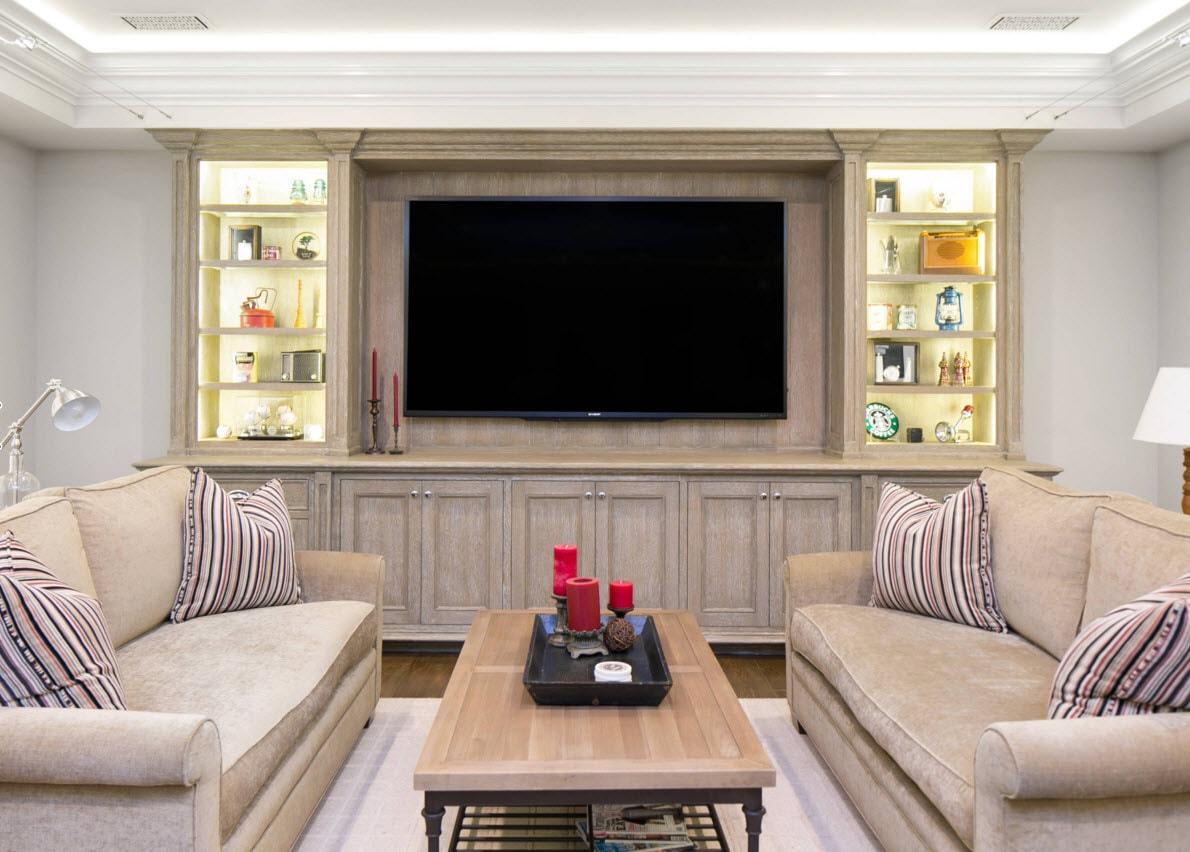 Storage Systems Variety for the Living Room. Royal decoration of the room with wooden panels and the highlighted shelving at the both sides from the TV zone