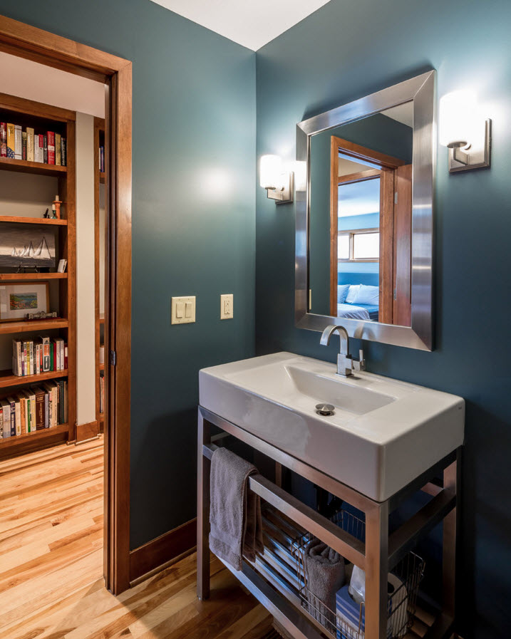 Nice high sink with cozy small tap and unusual color of the wall decoration