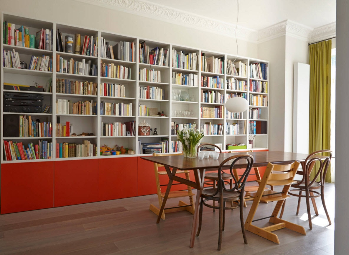 Storage Systems Variety for the Living Room. Typical library appearance with the table and chairs for reading