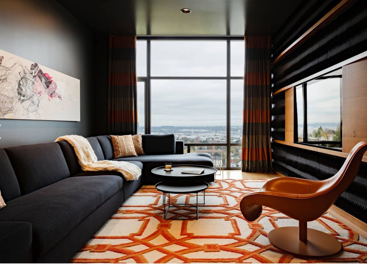 Living Room Curtains Design Ideas 2016. Unusual urbanistic futurism in the real small apartment in the skyscraper with orange pattern on the rug and the blinds