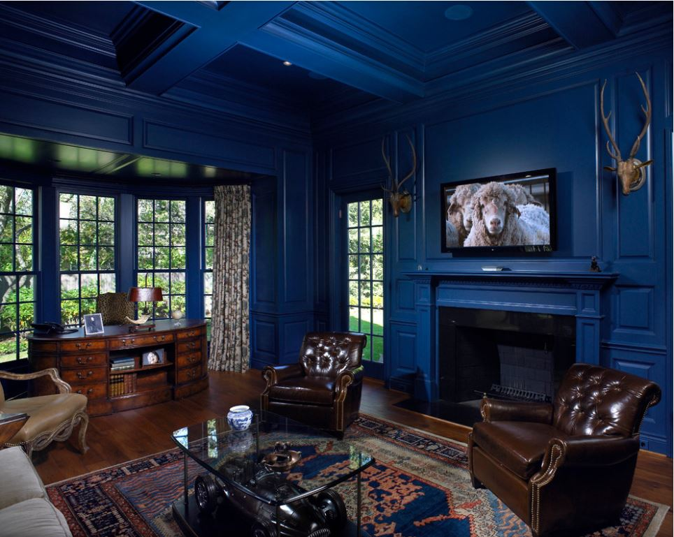 Blue Color Decoration Ideas for Living Room. Dark classic interior with leather chairs and fireplace