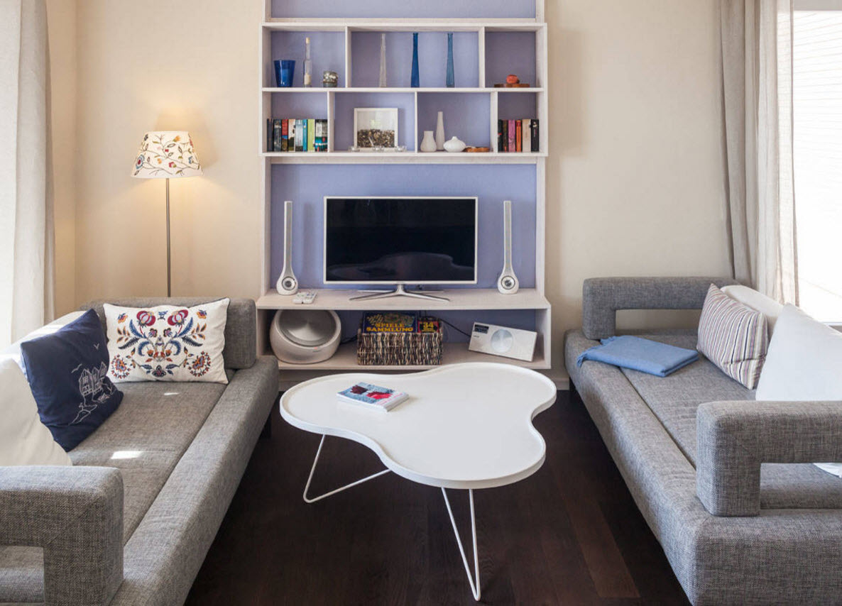Storage Systems Variety for the Living Room. Purple accent wall with tv, loudspeakers and shelving in the modern minimalistic interior with touch of eclecticism looks very impressive