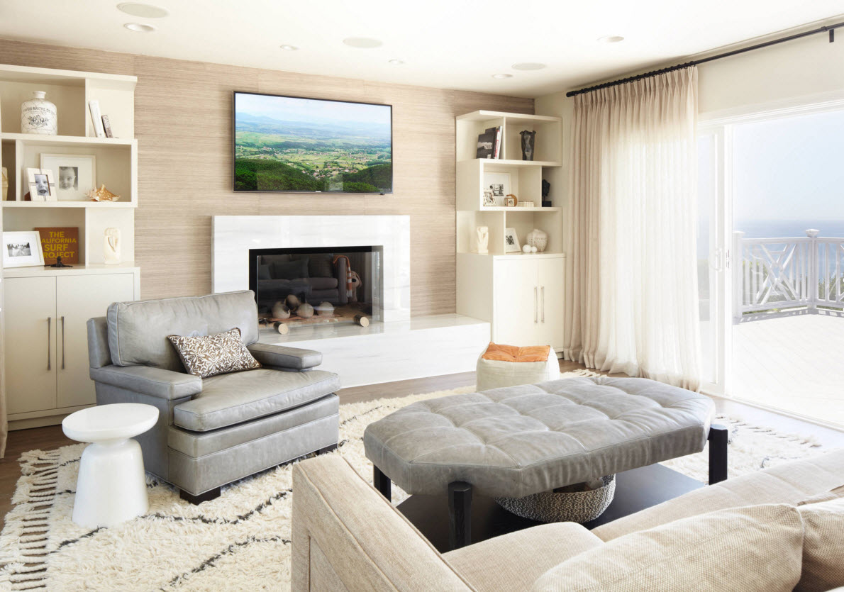Storage Systems Variety for the Living Room. Light creamy interior with the artificial fireplace and painting with the naturalistic theme and originally designed white shelves in the corner