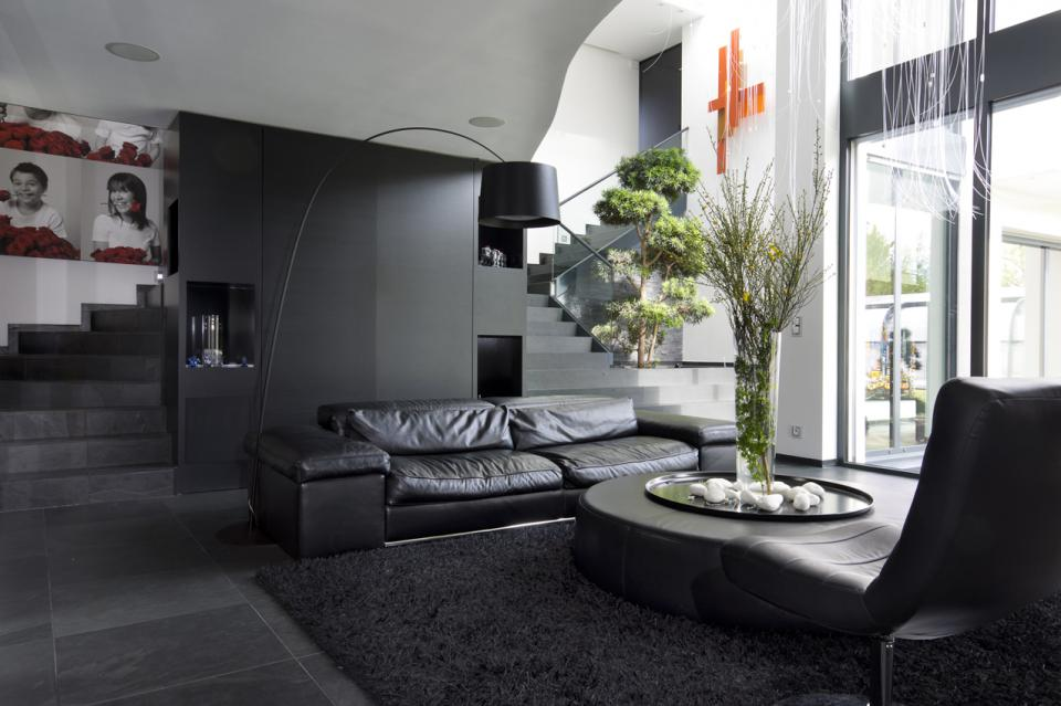 Black Furniture: Interior Design Photo Ideas. Nicely done interior of the maisonette apartment with living plants and black leather sofa