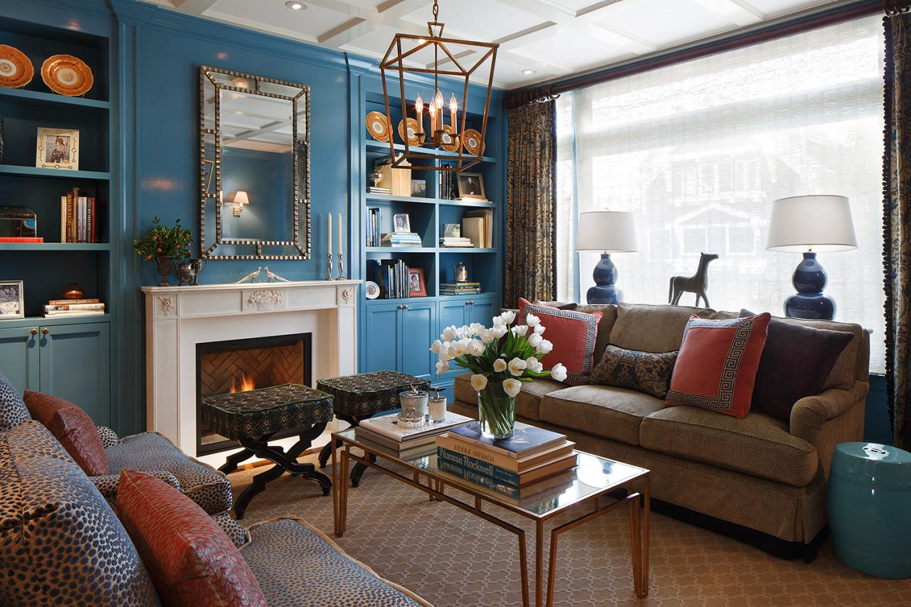Blue Color Decoration Ideas for Living Room. Nice tender color palette in the room with mirror above the fireplace and the book shelf