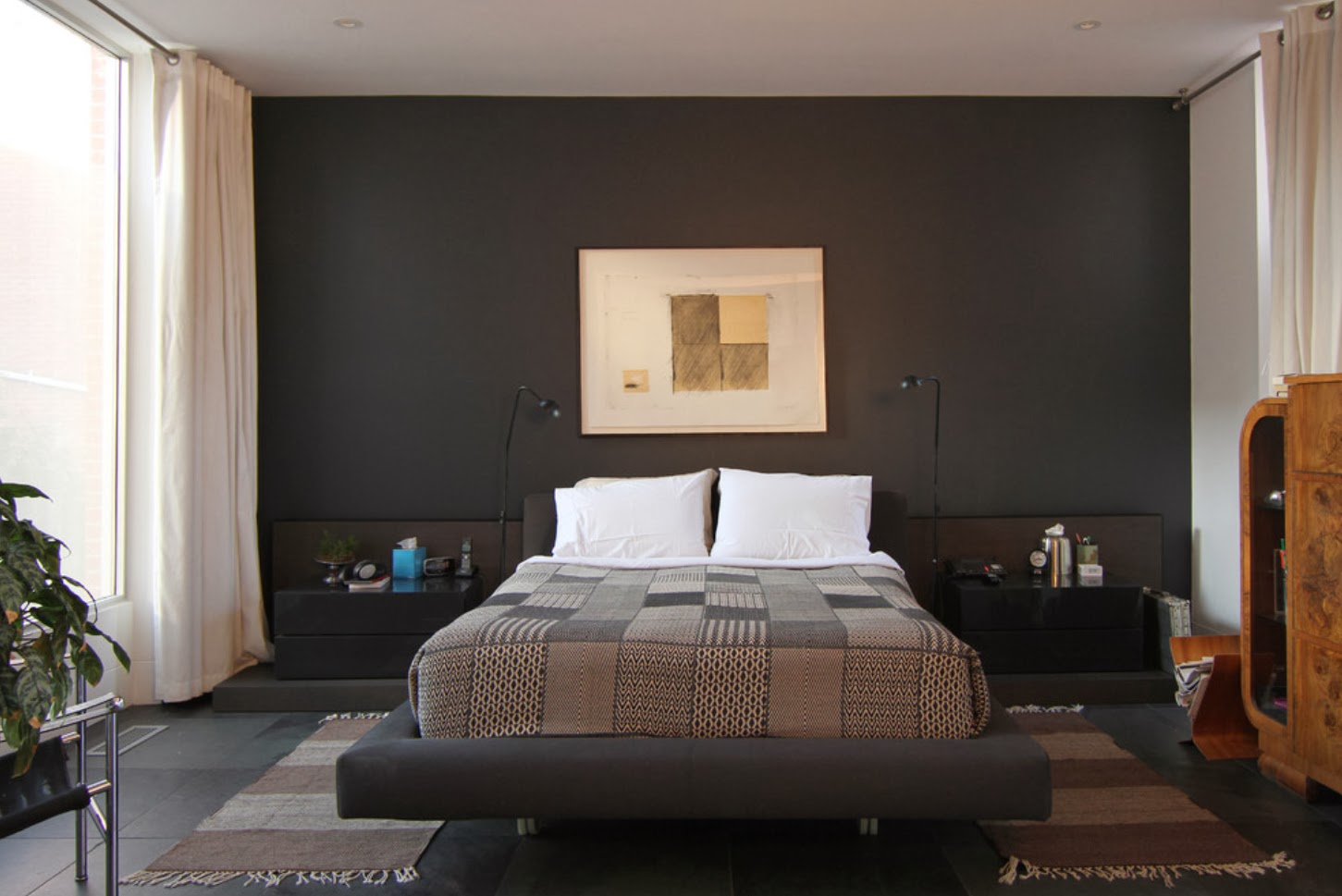 "Black Furniture: Interior Design Photo Ideas. Bed on the nice ""hovering"" stand and the impressionistic picture at the headboard"