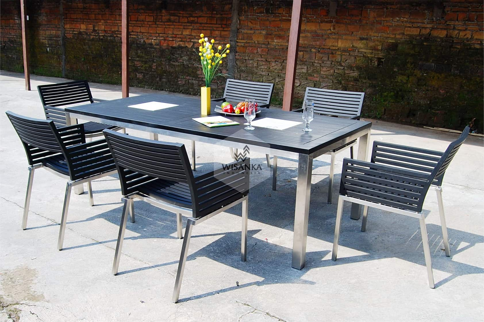Chromed legs and plastic top for black table and chair group for patio zone