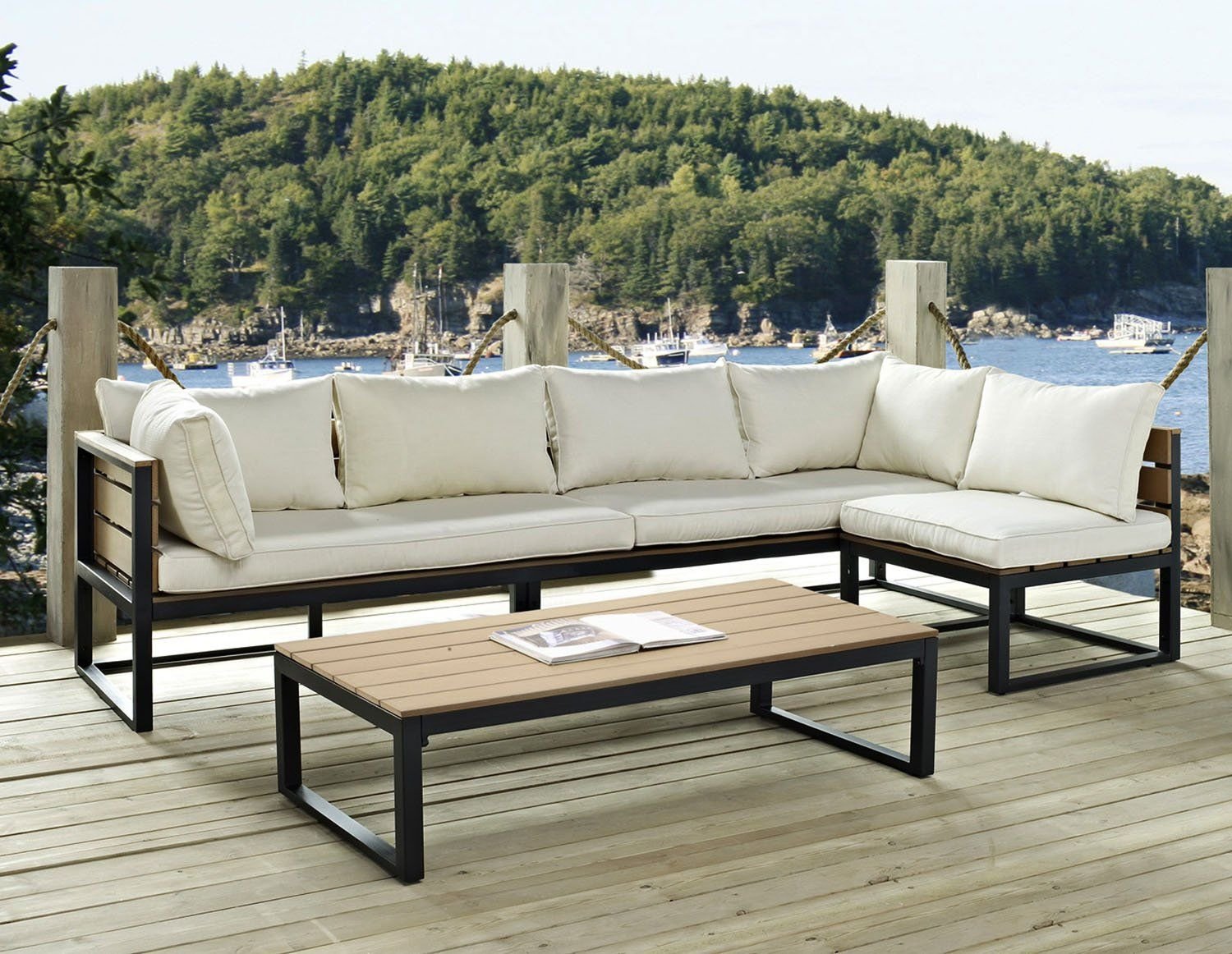 White cushions and black from for corner sofa at the open patio with low black framed table
