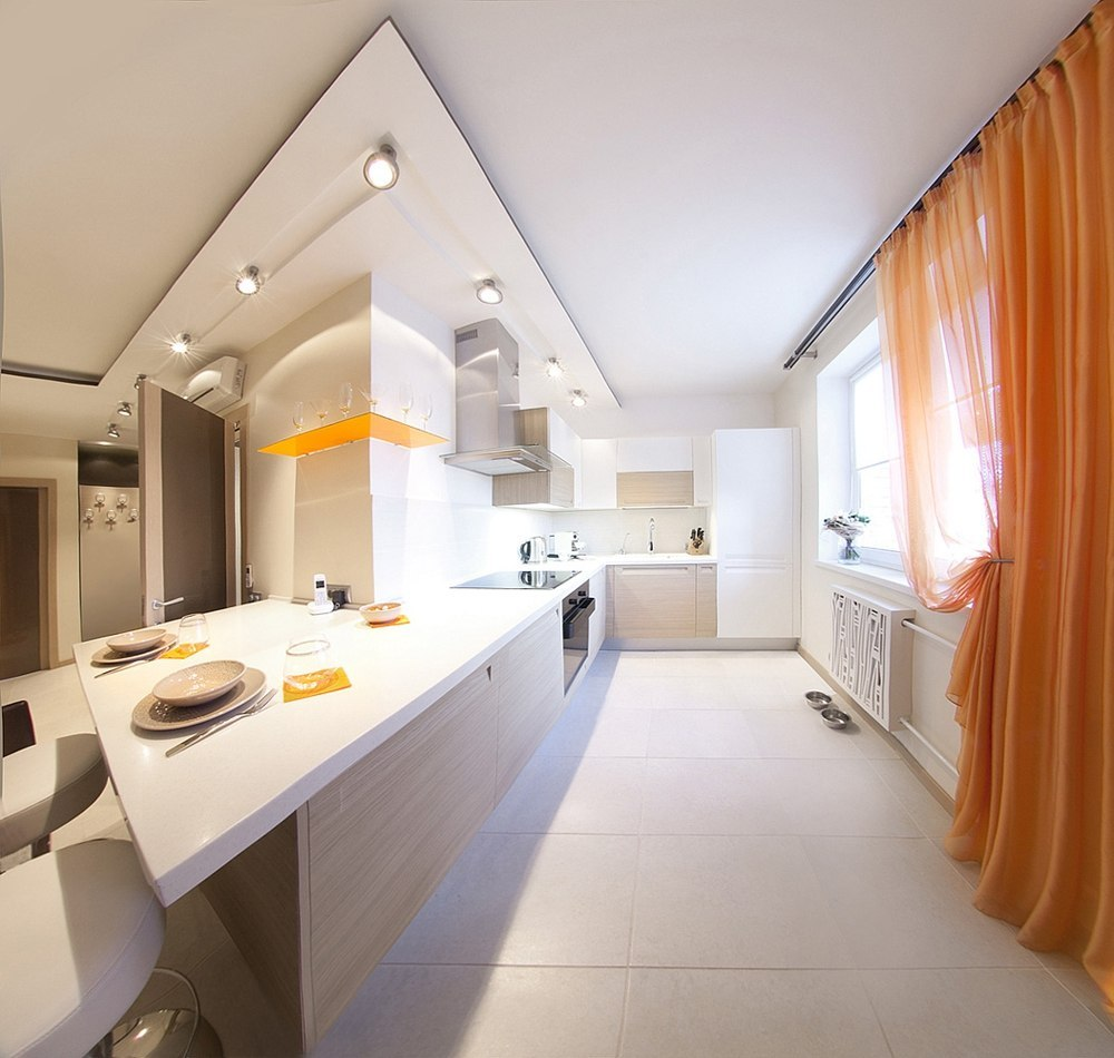 40 Square Meters Irregular Shape Apartment Photo Review. Angular transitions and the geometrically correct areas make a very organic symbiosis in the passage to the kitchen