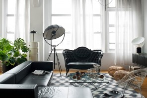 Black Furniture: Interior Design Photo Ideas. Corner sofa with unusual construction and the ottoman in front create the business image of the interior