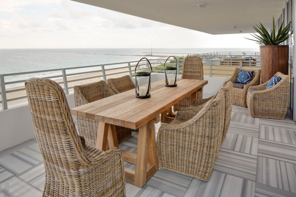 Modern Balconies Interior Design Ideas. Open layout of the balcony near the seashore with the dining group
