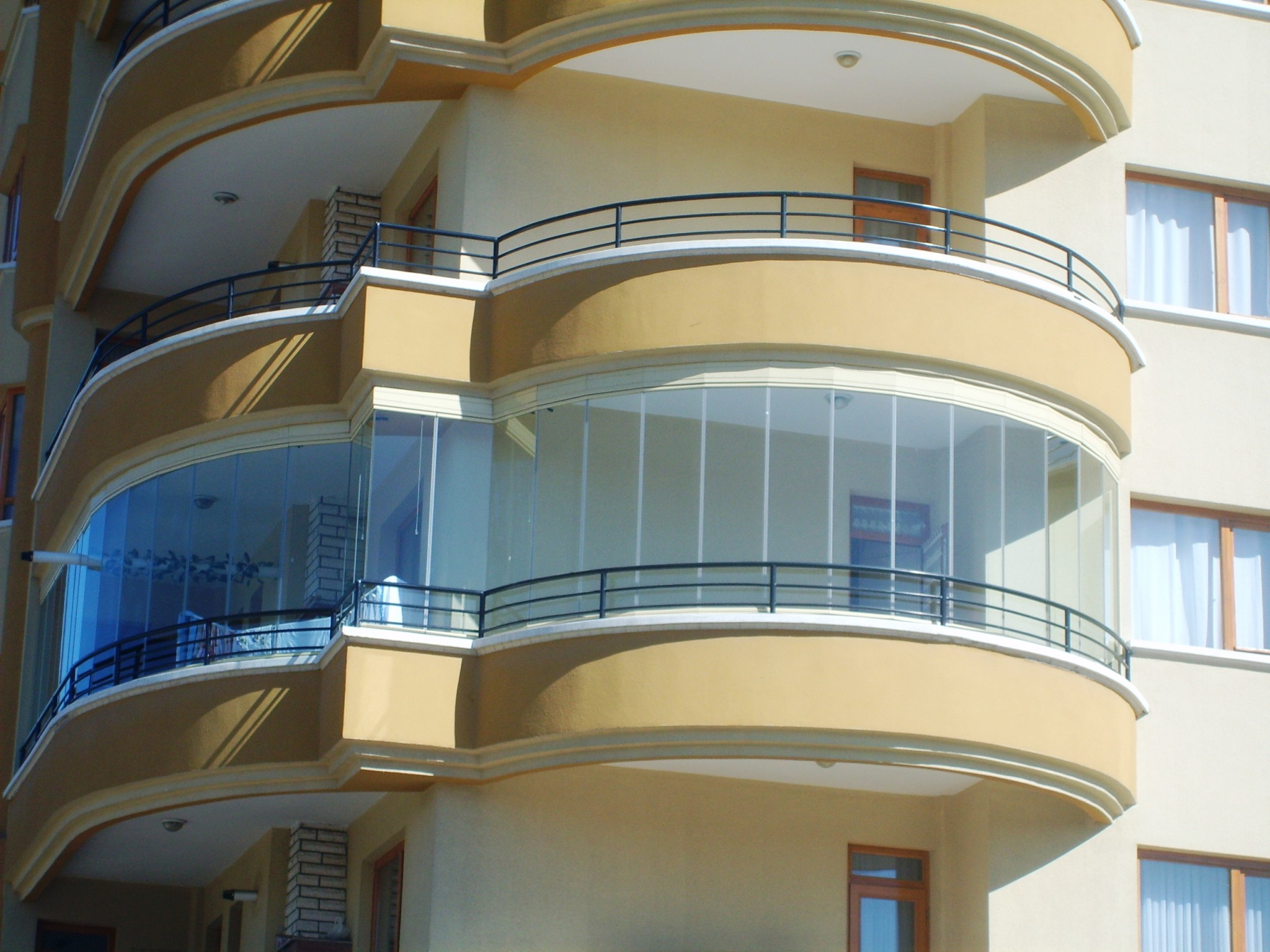 Modern Glazing for Balcony or Loggia. Spectacular solution for rounded balcony of the modern block of flats