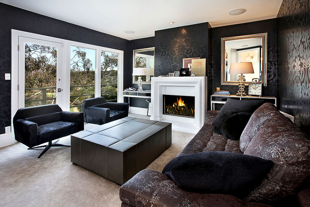 Black Furniture: Interior Design Photo Ideas. The fireplace with the white frame in the dark surroundings