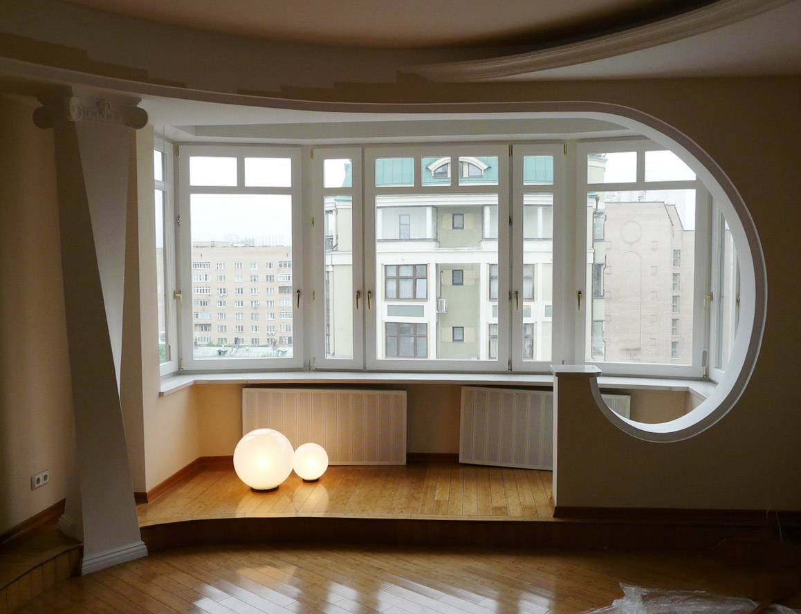 Modern Glazing for Balcony or Loggia. One whole room with the balcony equipped with warm floor technology
