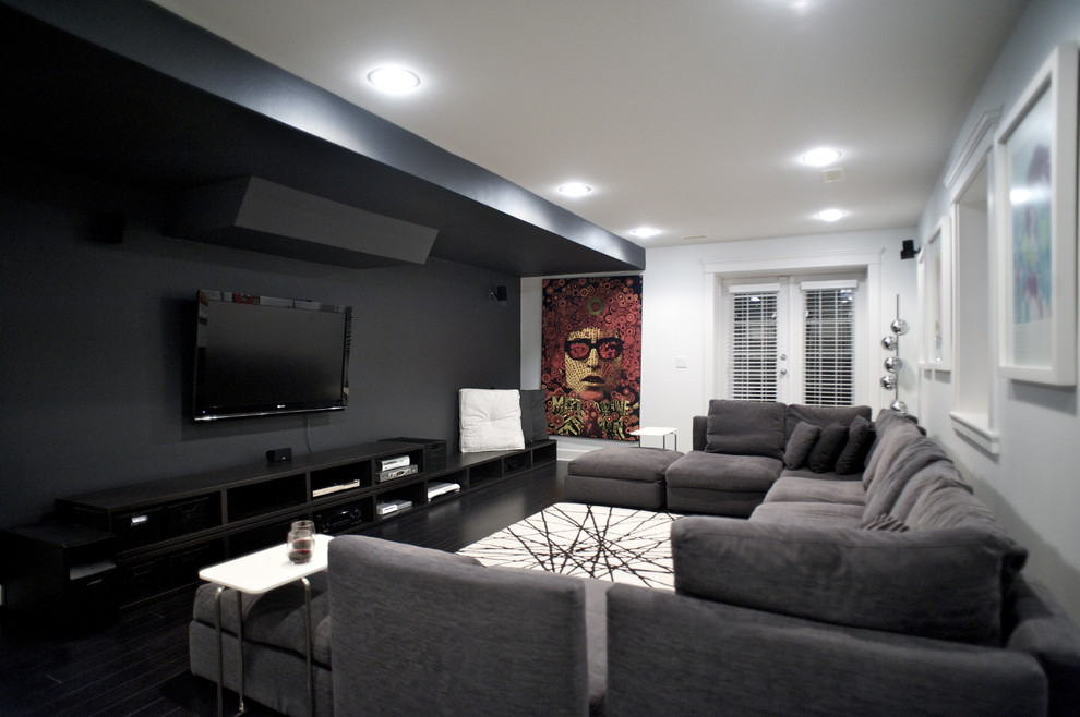 Black Furniture: Interior Design Photo Ideas. Black accent wall with the video area and the white rug contrast