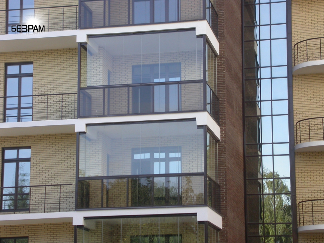 Modern Glazing for Balcony or Loggia. Cold glazing technology without frame and fence