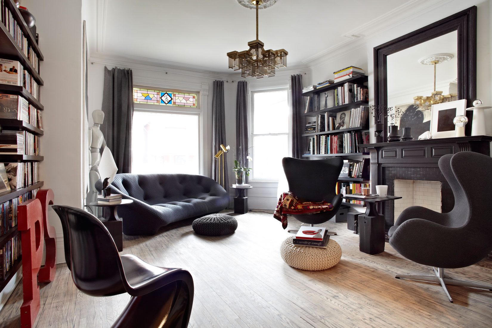 Black Furniture: Interior Design Photo Ideas. Contemporary noir style with lots of decorative elements and statuettes