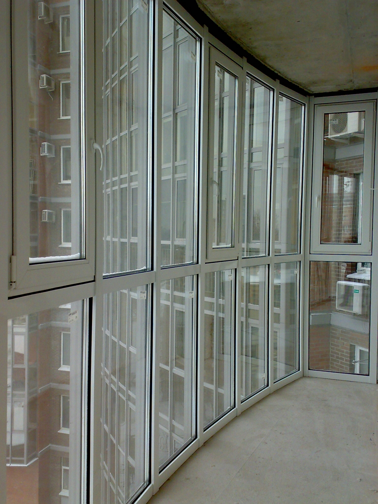 Modern Glazing for Balcony or Loggia. Wall-height frame of the window panes
