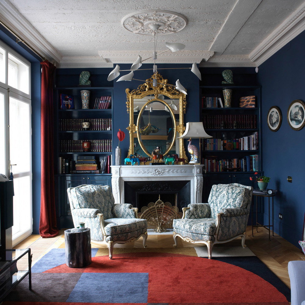 Blue Color Decoration Ideas for Living Room. Mirror and the fireplace in the room with stucco and plaster trimming in the classic style