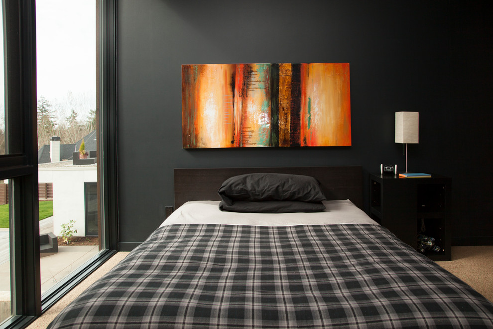 Black Furniture: Interior Design Photo Ideas. Black accent wall with bright painting and the gray coverlet of the bed blends into nice organic union