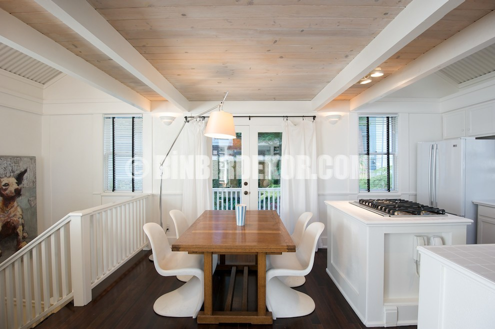 Nice white trimmed dining room with plastic chairs and light wooden intrusion