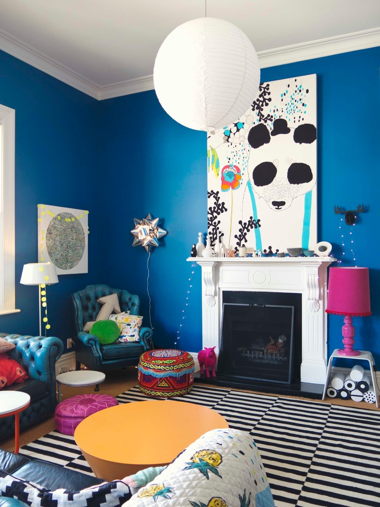 Blue Color Decoration Ideas for Living Room. Eclectic interior with impressionistic painting of the white accent wall