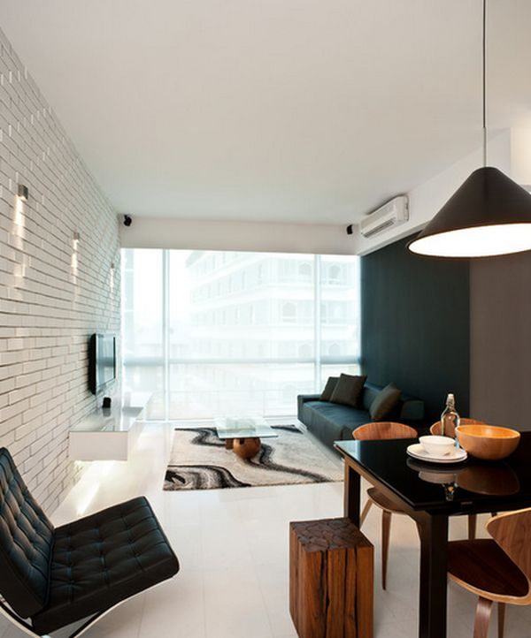 Black Furniture: Interior Design Photo Ideas. Unusual lamp with black paint and conу form, as well as wooden tabouret and the black leather folding couch in the steel frame hugely impact the overall perception of the premise
