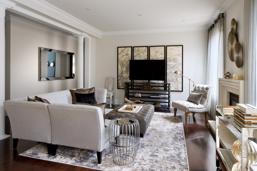 Classic Style Furniture fro Practical Chic Interiors. Black spor of the TV area in the bright living room