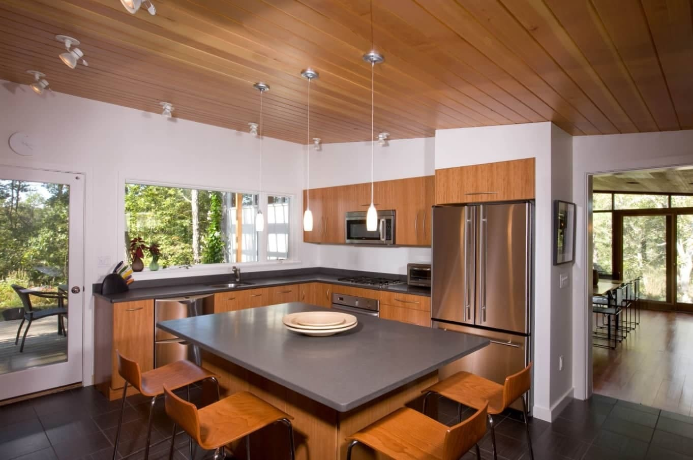 Top 15 Best Wooden Ceiling Design Ideas. Noble elm wood plank ceiling tint in modern kitchen interior with black table