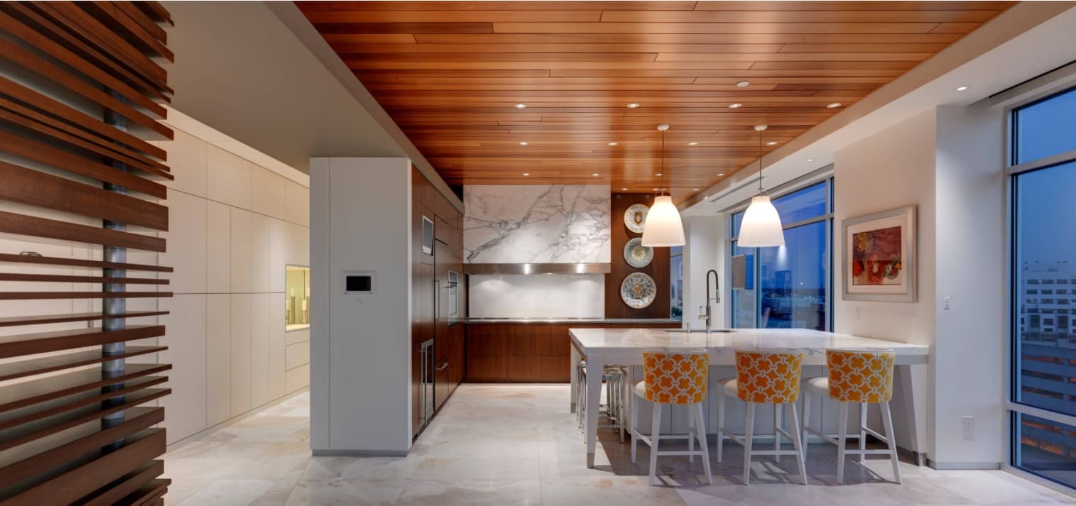 Lacquered wood plank ceiling for a great modern kitchen interior with white colored walls and furniture