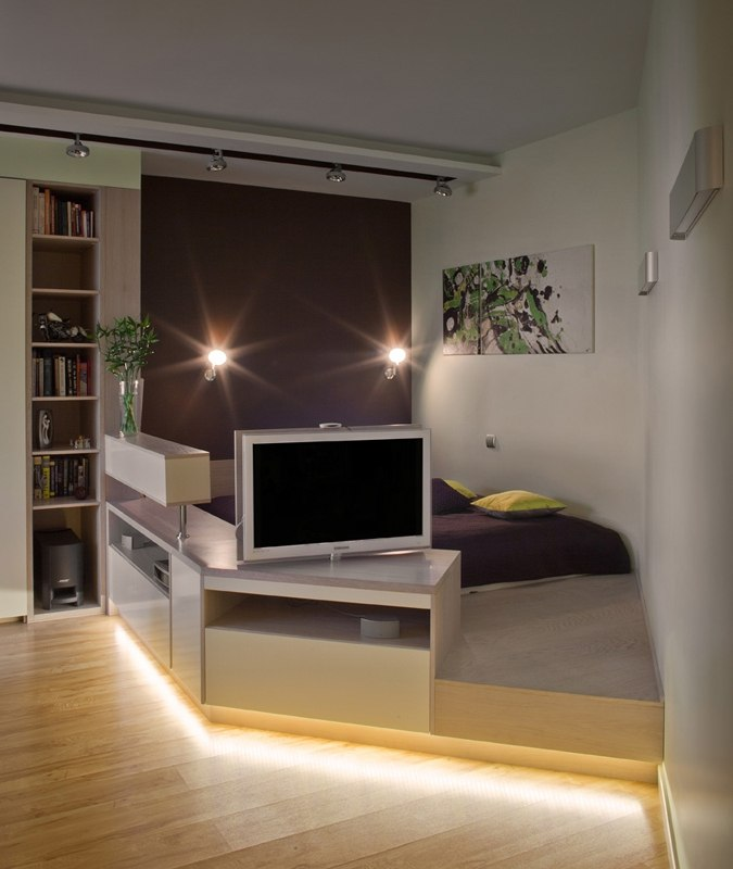40 Square Meters Irregular Shape Apartment Photo Review. Rest zone in the living room with the pedestal and artificial backlight