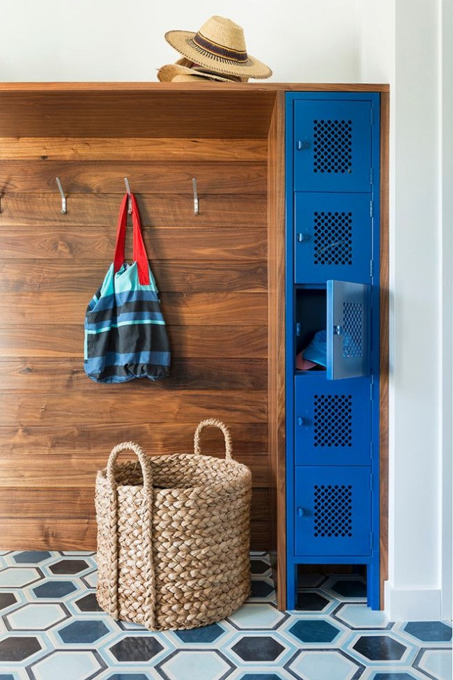 Nice blue tall and thin line of a box cabinet as an original design element in the apartment's hall