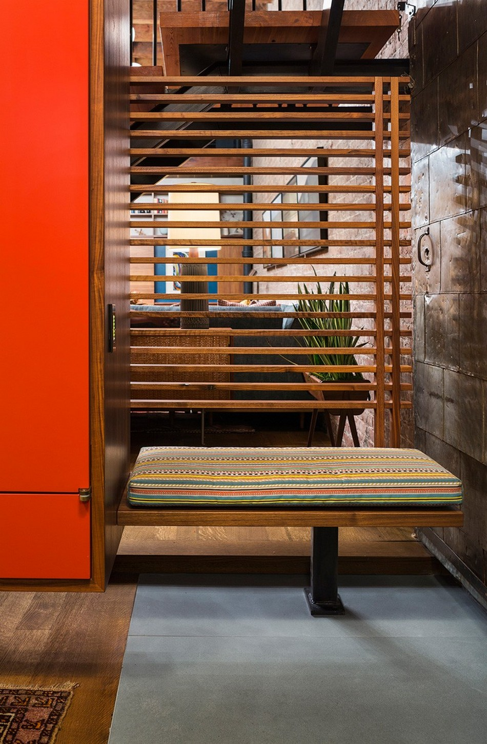 New York Loft Apartment of Former Warehouse. Wooden grid as the decoration of the bench for changing footwear
