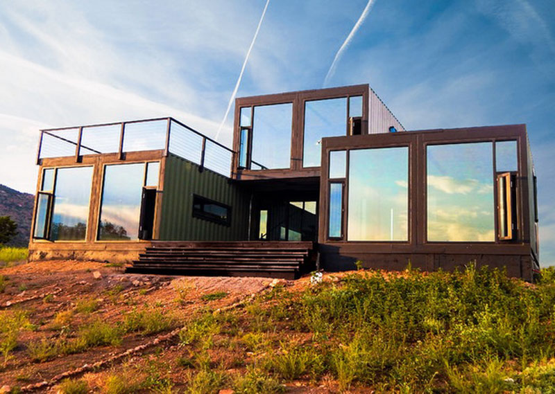 Cargo Container House Design Ideas. Glass mirroring surfaces of the panoramic windows