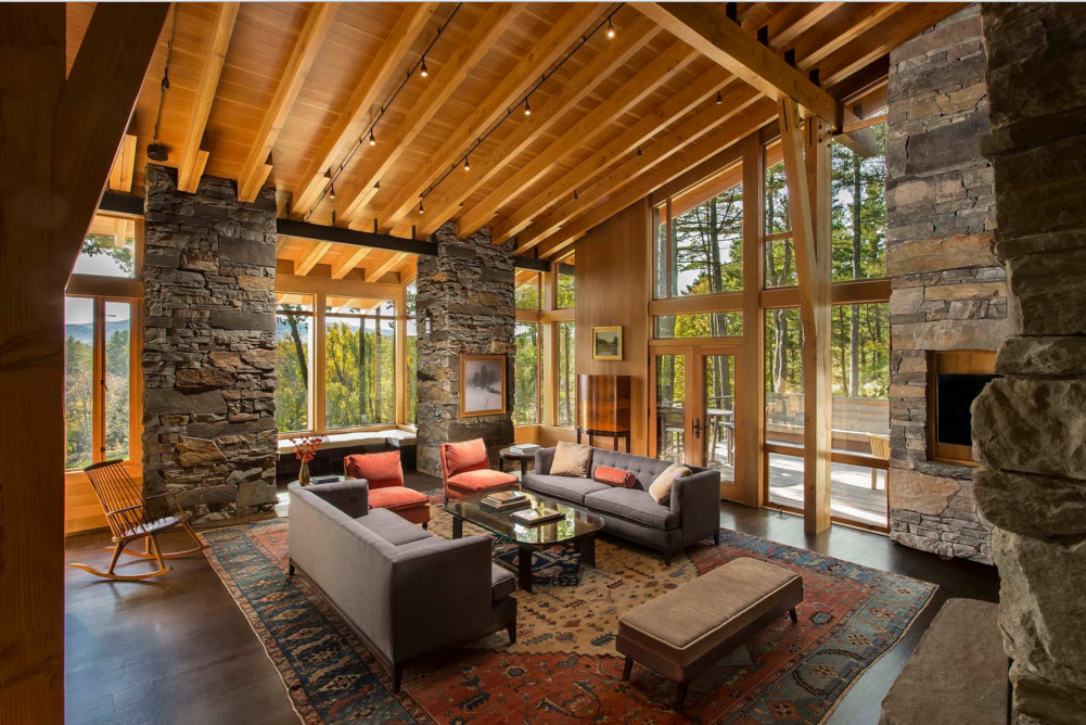 Light wooden living room with the panoramic windows and grid of ceiling beams