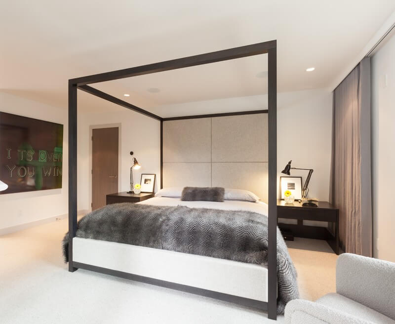Eco Style for Country House in the Pine Forest. Canopy frame in the bedroom with dark wooden trimming