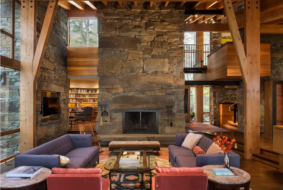 Overall look at the extremely high living room with the high windows and large supporting beams