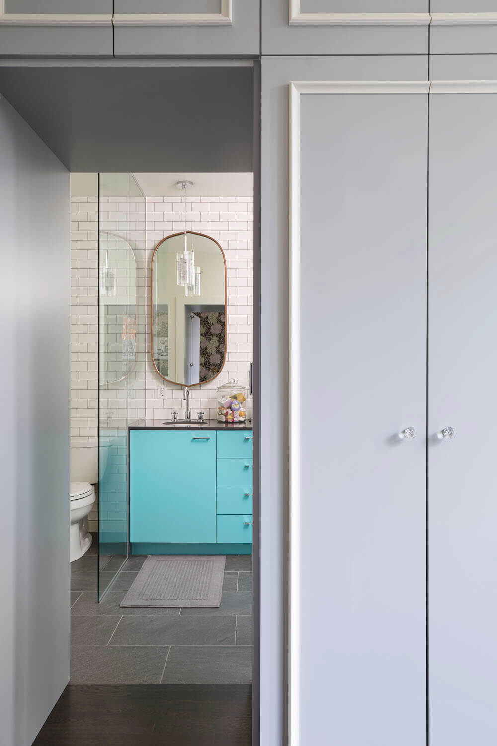 Bright Interior Design Ideas for Private House. Perspective view to the turquoise furniture set in the bathroom