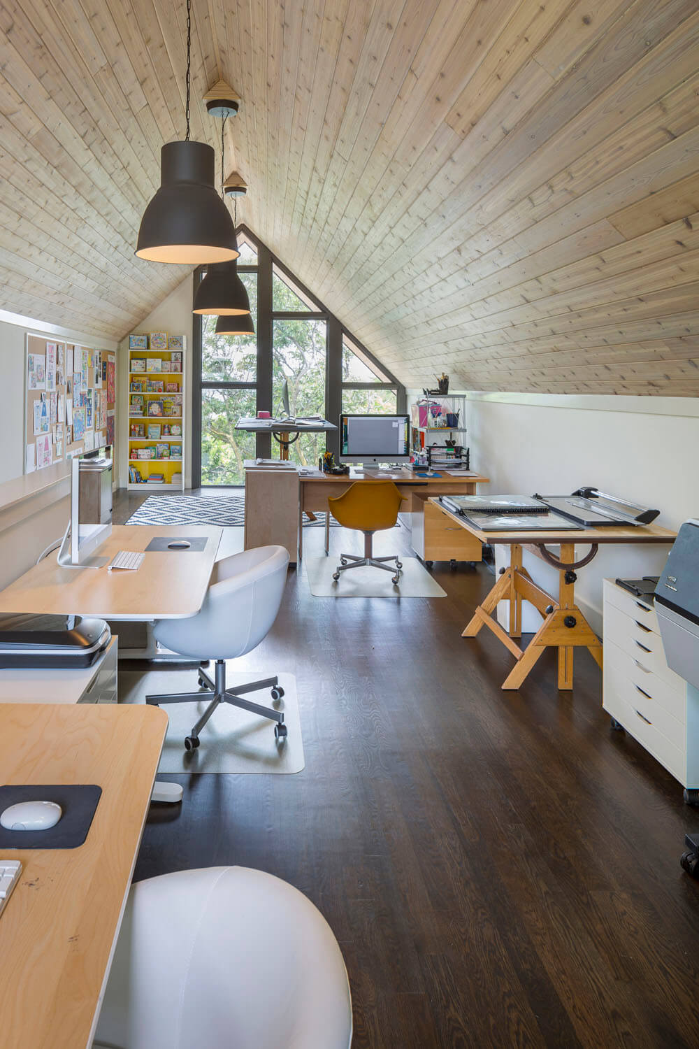Bright Interior Design Ideas for Private House. Working places of the home office at the loft with sloped wooden ceiling