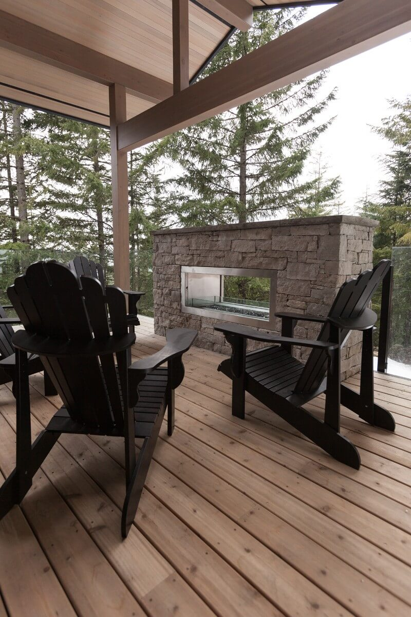Eco Style for Country House in the Pine Forest. Fresh air terrace with the brutal dark furniture