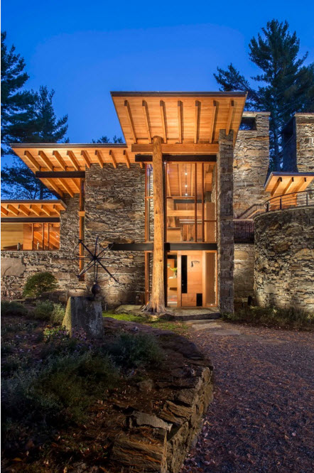 Modern Country Style Rural House. Stone finished walls and far protruding roof canopies