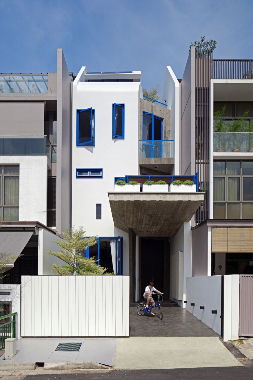 Original Compact Private House Design. Original blue and white facade
