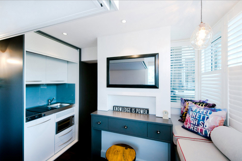 Large TV-panel as the design element of the extra small interior