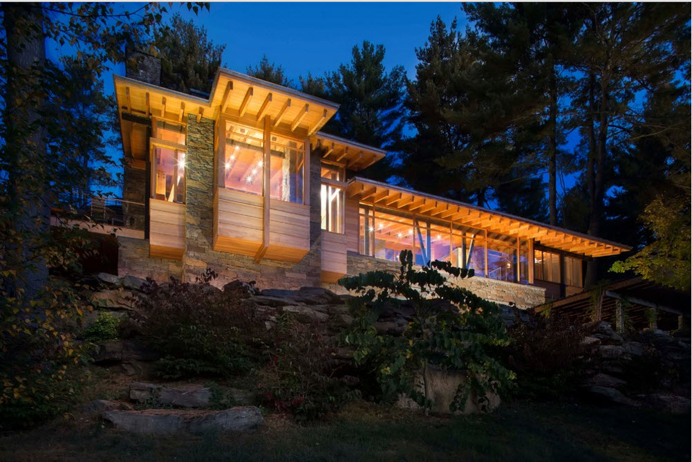 rocky landscape with the reviewed wooden dream house in country style